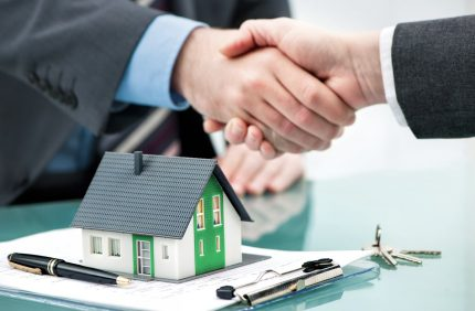 Handshake house key contract signing hands mortgage contract shutterstock 375747523